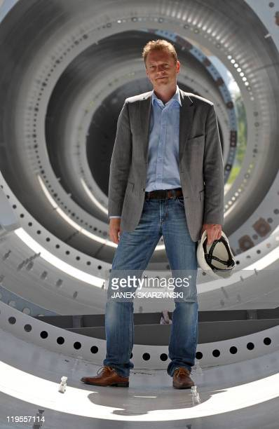 Mary Sibierski Thomas Gaardbo vice president of GSG Towers stans inside a new wind tower in Gdansk Shipyard in northern Poland on June 23 2011 In...
