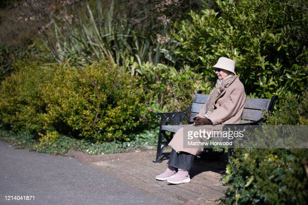 Mary sits alone in Cathays Park during a period of selfisolation on Mother's Day on March 22 2020 in Cardiff United Kingdom On Friday UK Prime...