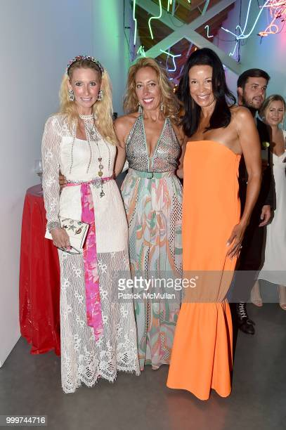 Mary Snow Tatiana Platt and Kim Heirston Evans attend the Parrish Art Museum Midsummer Party 2018 at Parrish Art Museum on July 14 2018 in Water Mill...