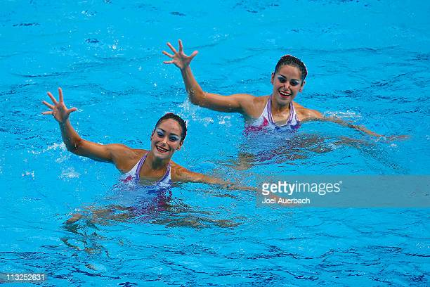Mary Soto and Anna Soto of Venezuela perform their synchronized swimming duet technical routine at the 2007 XV Pan American Games on July 25 2007 at...