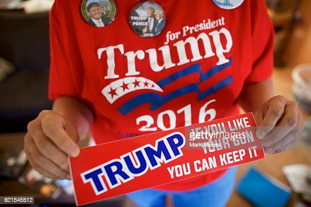 Mary Strohmeyer displays a Donald Trump campaign bumper sticker November 5 2016 in Lancaster Pennsylvania In support of the Republican Presidential...