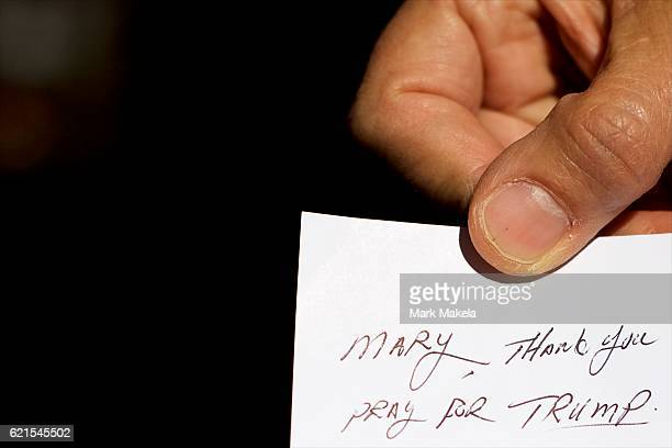 Mary Strohmeyer holds a note written to her from a friend asking to pray for Trump November 5 2016 in Lancaster Pennsyvalnia A Trump supporter...