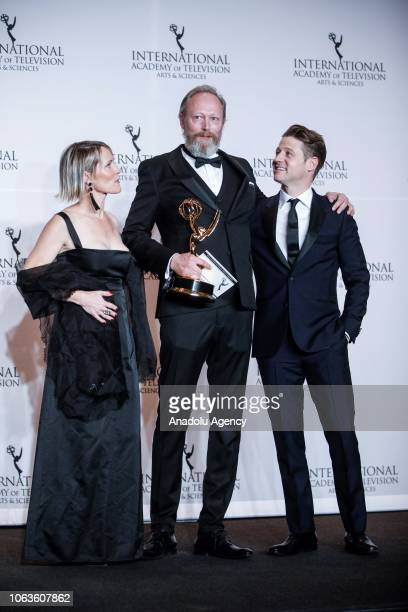 Mary Stuart Masterson Lars Mikkelsen and Ben McKenzie give a pose with their award during the 46th International Emmy Awards at New York Hilton on...