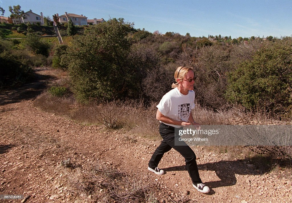 Mary Sue Maurer, walks along a trail on the 31 acre site where the Las Virgenes School District prop : News Photo