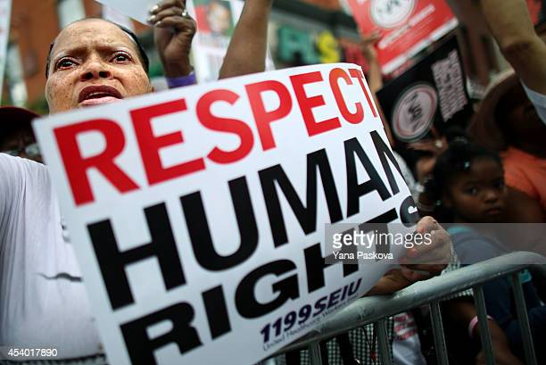 Mary Thurman prepares to march in a rally against police violence on August 23 2014 in the Staten Island borough of New York City Thousands of...