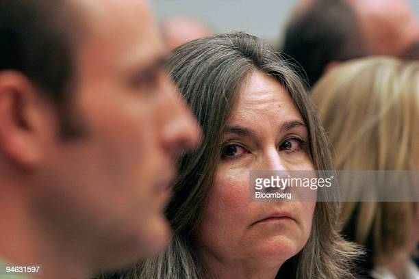 Mary Tillman the mother of Army Ranger and professional football player Pat Tillman looks over at her son Kevin Tillman during a hearing of the House...
