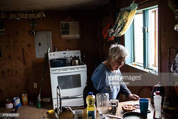 Mary Tom makes a cup of tea in her house on July 3 2015 in Newtok Alaska Newtok is one of several remote Alaskan villages that is being forced to...