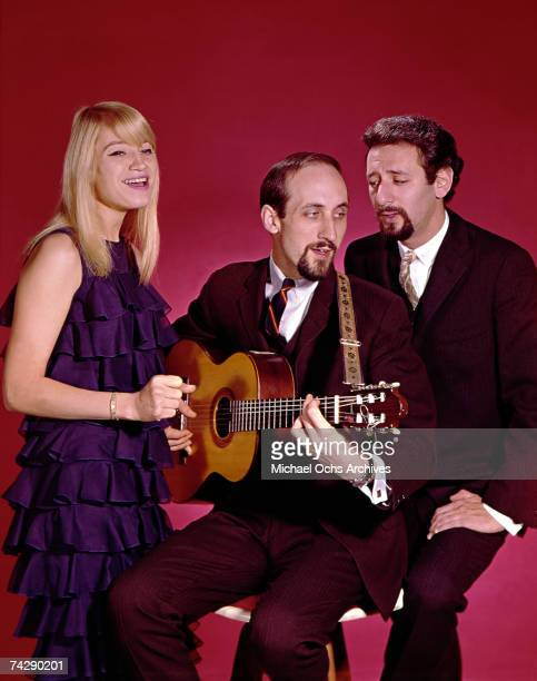 Mary Travers Paul Stookey and Peter Yarrow of the folk group Peter Paul Mary perform on stage in circa 1965 in New York City New York