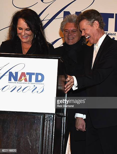 Mary Travis addresses the gala after Marty Stuart presents to Honoree Randy Travis during the 2016 NATD Honors Gala at Hermitage Hotel on November 9...
