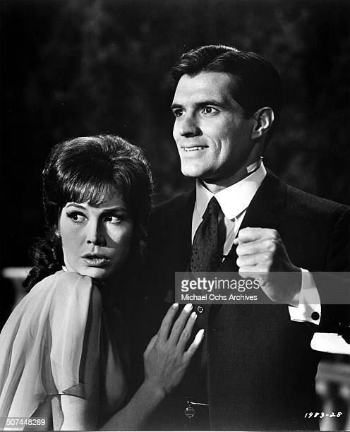 Mary Tyler Moore clings to John Gavin in a scene from the Universal Studio movie Thoroughly Modern Millie circa 1967