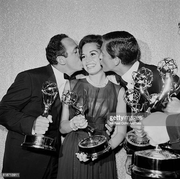 Mary Tyler Moore is kissed by costars after receiving the Emmy Award for The Dick Van Dyke Show in Los AngelesCA