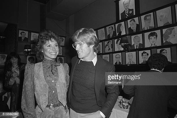 Mary Tyler Moore star of the film Ordinary People and the movie's director Robert Redford chat January 25 at Sardi's during the 45th annual New York...