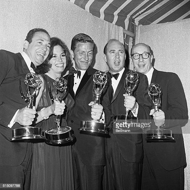 Mary Tyler Moore who plays the television wife of Dick Van Dyke on the Dick Van Dyke Show gets a big kiss from Van Dyke after they won Emmy's as...