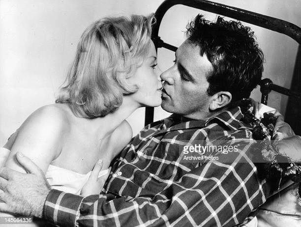 Mary Ure and Richard Burton kissing in the bed in a scene from the film 'Look Back In Anger', 1959.