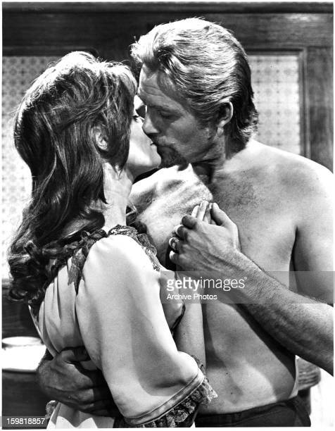 Mary Ure kisses Robert Shaw in a scene from the film 'Custer Of The West', 1967.