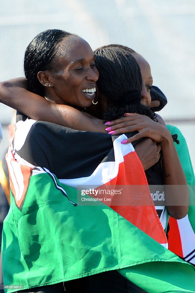 Mary Wacera Ngugi, Gladys Cherono and Selly Chepyego Kaptich of Kenya celebrate their first, second and third positions after the IAAF/Al-Bank World Half Marathon Championships on March 29, 2014 in Copenhagen, Denmark.