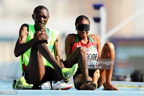 Mary Waithera Njoroge of Kenya and guide Joseph Rotina recover after the Women's 1500m T13 during Day Eight of the IPC World Para Athletics...