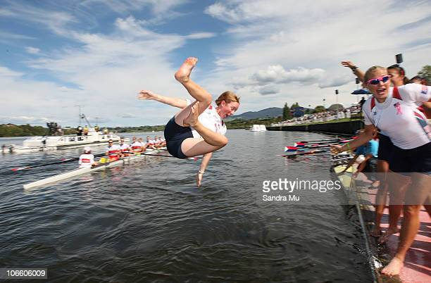 Mary Whipple of USA is traditionally thrown into the water after winning gold in the Women's Eight Final during day eight of the World Rowing...