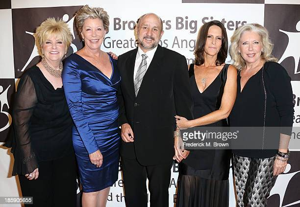 Mary Willard Sarah Parcell Roy P Disney Chairman/CEO Founder The Apogee Companies Sheri Disney and Sandy Bilson attend The Guild of Big Brothers Big...