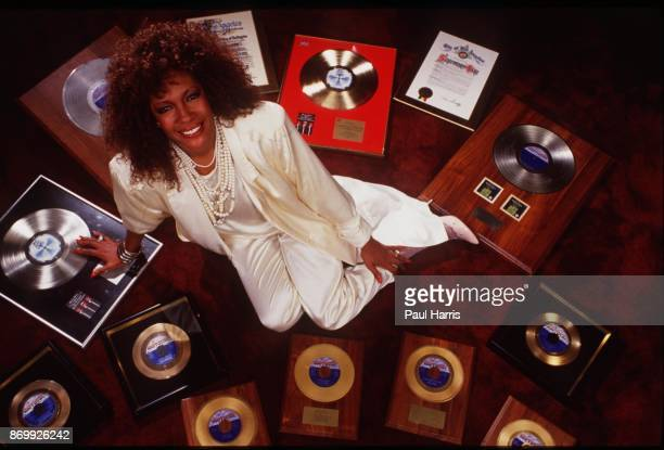 Mary Wilson of the Supremes and her collection of gold and silver records photographed at a hotel in Los Angeles California April 12 1985