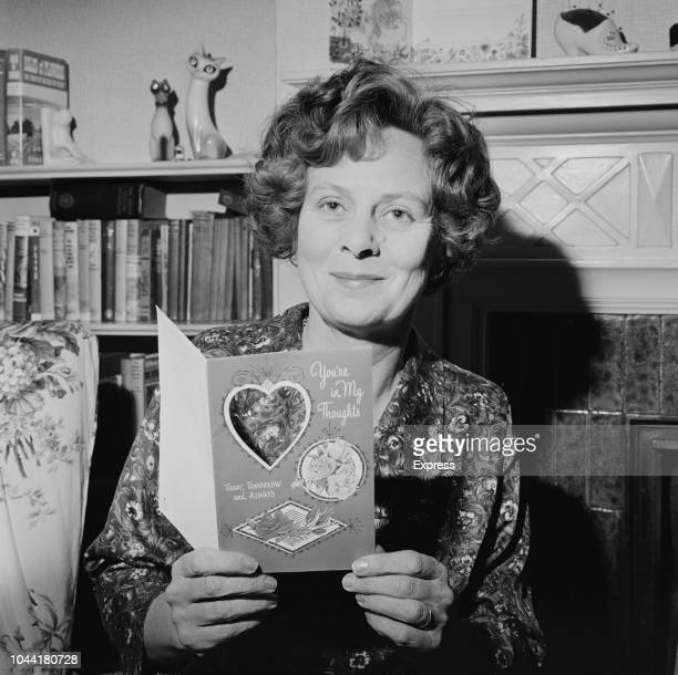Mary Wilson wife of British Labour Party politician Harold Wilson pictured holding a greetings card at home after her husband was selected as the new...