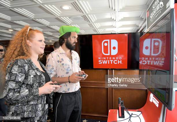 Mary Wiseman and Shazad Latif test their skills on Super Smash Bros Ultimate for Nintendo Switch at the Variety Studio at ComicCon 2018 on July 20...