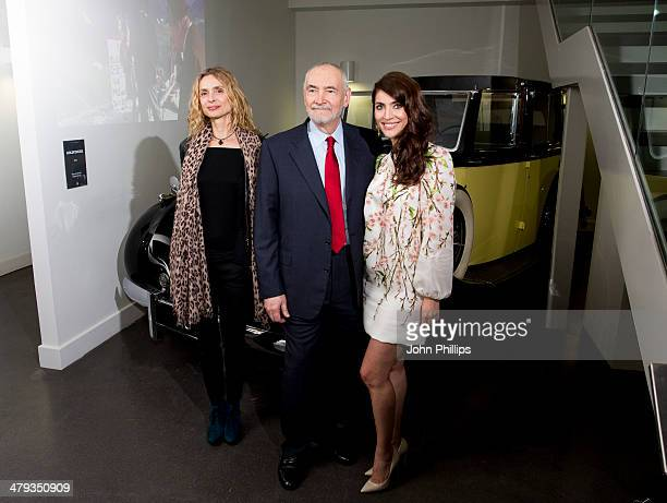 Maryam d'Abo and producer Michael G Wilson and Caterina Murino attends a photocall ahead of the opening of the Bond In Motion exhibition at the...