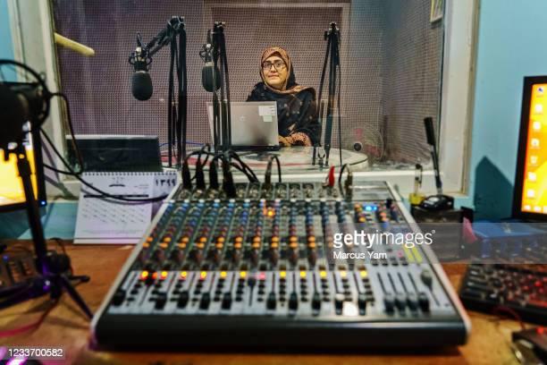 Maryam Durani poses for a portrait inside her organizationsÕ radio station in Kandahar, Afghanistan, Saturday, May 8, 2021. Since 2004, Durani, an...