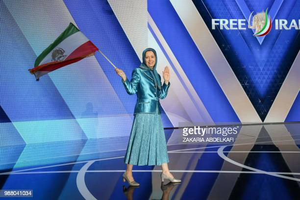 Maryam Rajavi leader of the People's Mujahedin of Iran salutes her supporters as she arrives for the meeting Free Iran 2018 the Alternative organised...