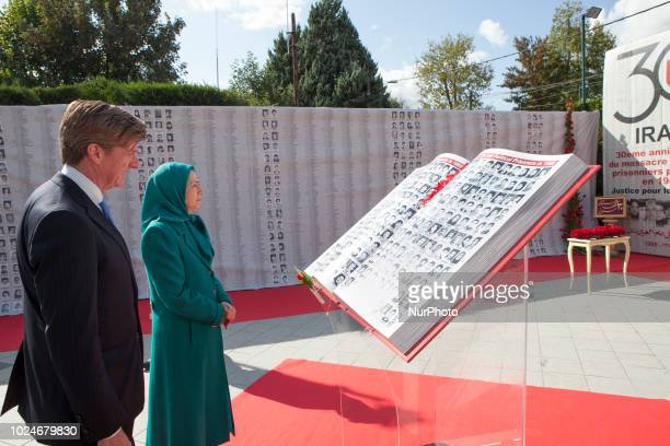 Maryam Rajavi Patrick Kennedy AuverssurOise France Iranians commemorated the 30000 political prisoners massacred in 1988 in Iran in an online...