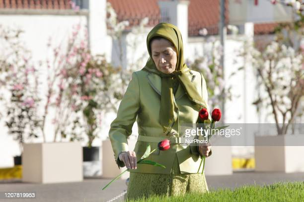 Maryam Rajavi Presidentelect of the National Council of Resistance of Iran laying wreath at the Monument of the martyrs who made the ultimate...