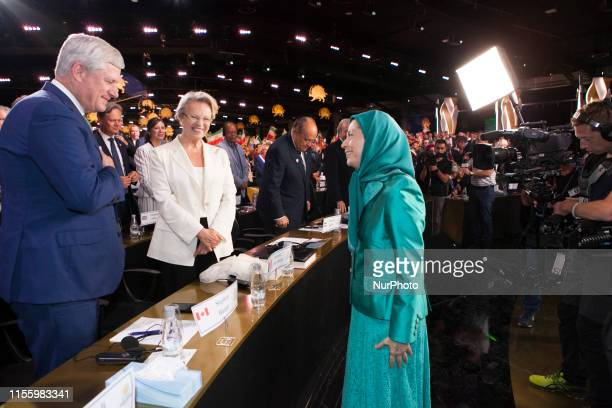Maryam Rajavi Rudy Giuliani Michele AliotMarie Stephen Harper Duress Albania The annual Free Iran Conference for the first time at Ashraf 3 the...