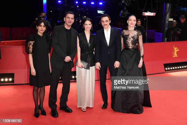Maryam Zaree director Christian Petzold Paula Beer Franz Rogowski and Anne RattePolle pose at the Undine premiere during the 70th Berlinale...
