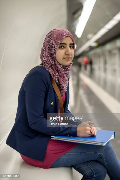 Maryame from Morocco poses for a portrait on the subway on November 01 2013 in Barcelona Spain Maryame is a qualified nursing assitsant and she was...