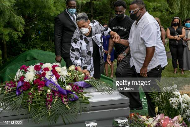 Maryann Coleman mourns the death of her son Conrad Coleman Jr. At his burial on July 03, 2020 in Rye, New York. Conrad Coleman Jr died of Covid-19 on...