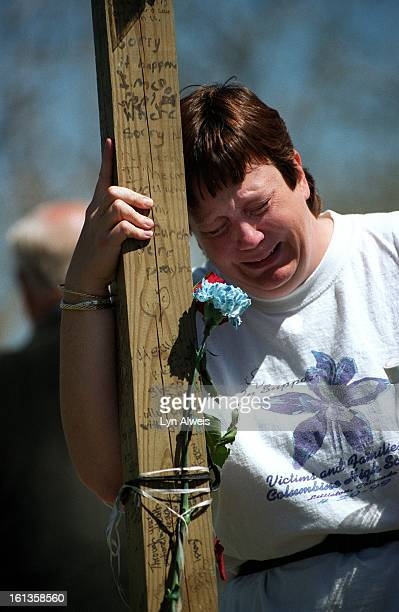 MaryAnne Mueller of Littleton breaks down and cries at the cross of Columbine victim Rachel Scott in Clement Park Greg Zanis from Aurora Illonois...