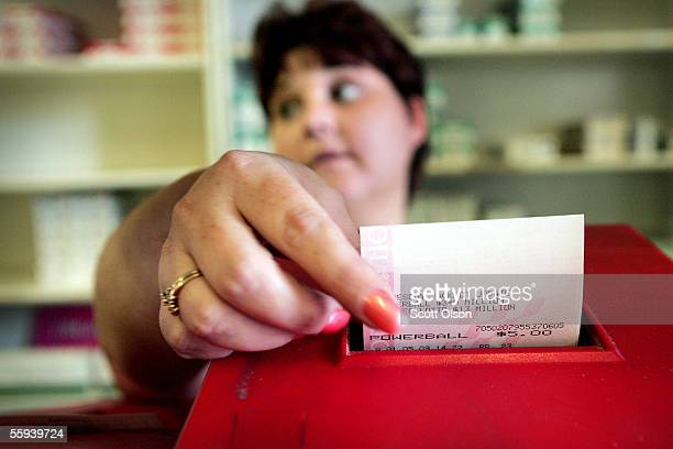 Maryanne Rearick rings up Powerball lottery tickets for customers at a cigarette store October 17 2005 in Whiting Indiana The numbers for the...