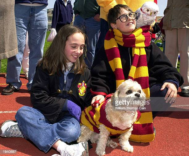 Marybeth Grasso of Ocean City New Jersey and her cousin Stacey Grasso of Lower Merion Pennsylvania dressed as Harry Potter watch the festivities with...