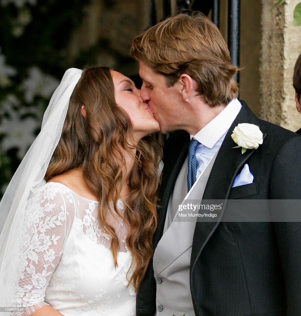 Mary-Clare Winwood and Ben Elliot kiss as they leave the church of St. Peter and St. Paul, Northleach after their wedding on September 10, 2011 in Cheltenham, England.