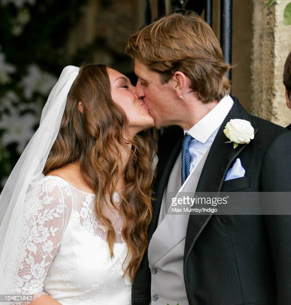 MaryClare Winwood and Ben Elliot kiss as they leave the church of St Peter and St Paul Northleach after their wedding on September 10 2011 in...