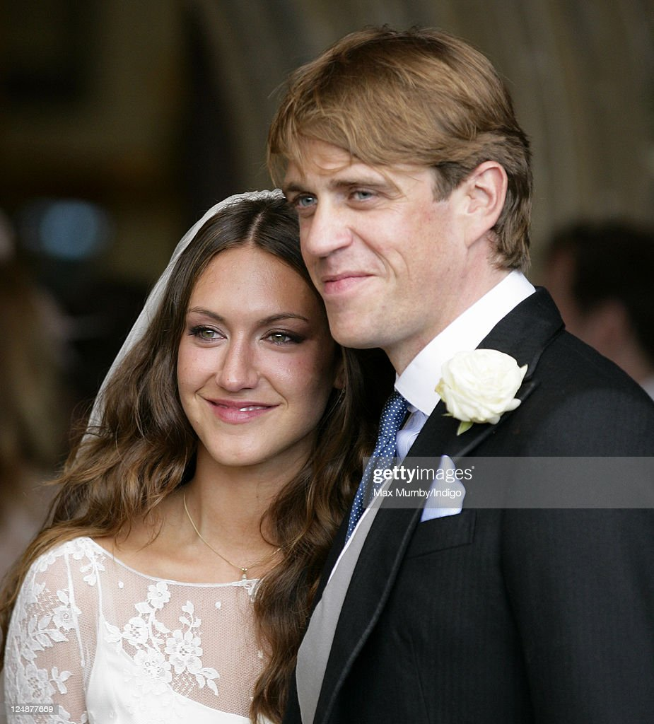 Mary-Clare Winwood and Ben Elliot leave the church of St. Peter and St. Paul, Northleach after their wedding on September 10, 2011 in Cheltenham, England.