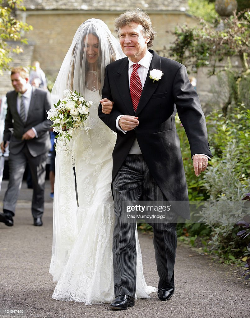 Mary-Clare Winwood and Steve Winwood arrive at the church of St. Peter and St. Paul, Northleach for Mary-Clare's wedding to Ben Elliot on September 10, 2011 in Cheltenham, England.