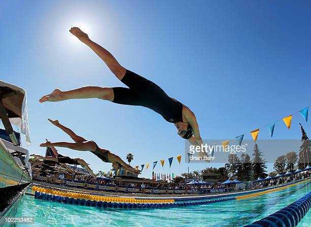 Maryella Randall Rachael Acker and Erica Malagon dive off the blocks for the start of the 12th heat of the womens 50 meter freestyle prelims at the...