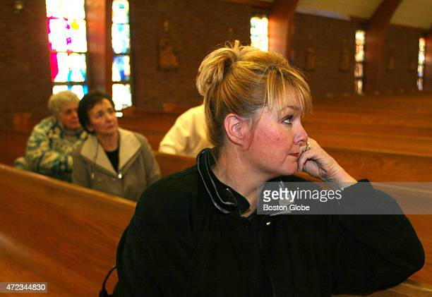 Maryellen Rogers a parishioner at St Frances Xavier Cabrini participates in a vigil on October 26 2004 inside the church which is scheduled to close...