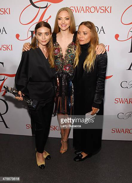MaryKate Olsen Amanda Seyfried and Ashley Olsen pose on the winners walk at the 2015 CFDA Fashion Awards at Alice Tully Hall at Lincoln Center on...