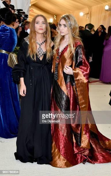 MaryKate Olsen and Ashley Olsen attend the Heavenly Bodies Fashion The Catholic Imagination Costume Institute Gala at The Metropolitan Museum of Art...