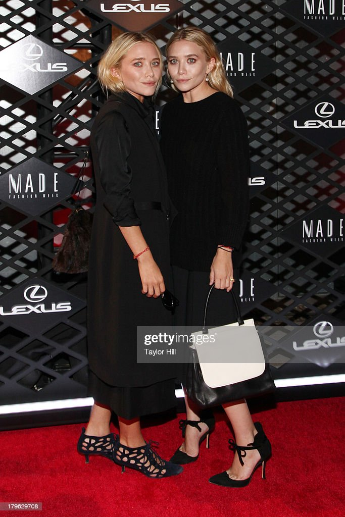 Mary-Kate Olsen and Ashley Olsen attend the Lexus Design Disrupted Fashion Event at SIR Stage 37 on September 5, 2013 in New York City.