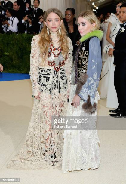 MaryKate Olsen and Ashley Olsen attend the 'Rei Kawakubo/Comme des Garcons Art Of The InBetween' Costume Institute Gala at Metropolitan Museum of Art...