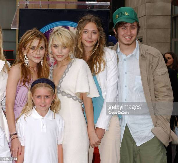 Mary-Kate Olsen and Ashley Olsen with half-sister , sister Lizzie and brother Trent
