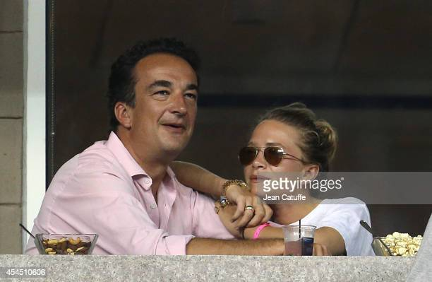 MaryKate Olsen and her boyfriend Olivier Sarkozy brother of former French President Nicolas Sarkozy attend Day 8 of the 2014 US Open at USTA Billie...